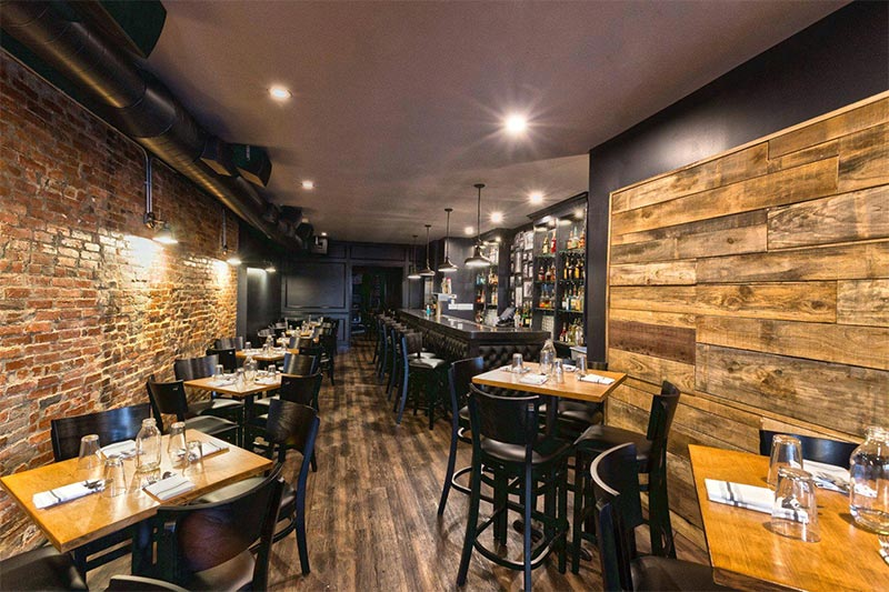 Exposed brick and rustic wood paneling in restuarant