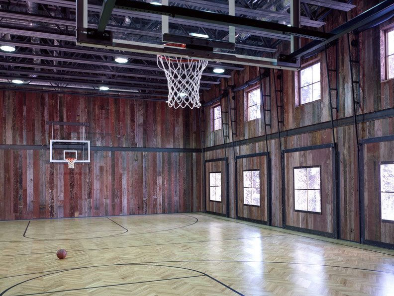 Rustic wood paneling basketball court
