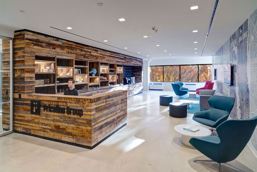 Priceline lobby uses reclaimed wood reception desk and paneling