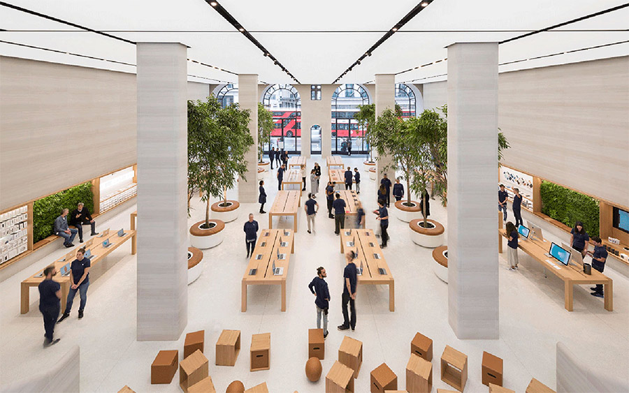 Apple retail location has copious amounts of natural light and greenery