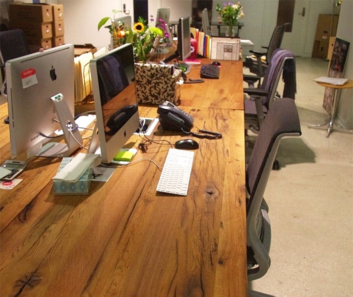 Reclaiemd Wood tables in hotel office space