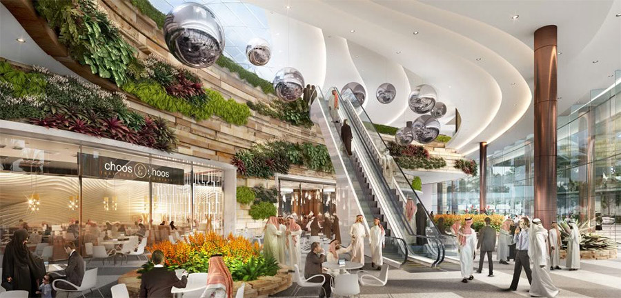 Shopping center mall features vibrant plants and natural light