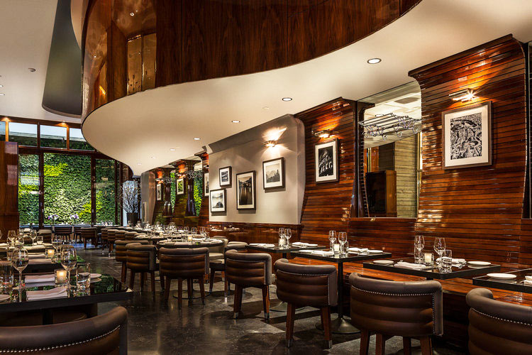 Curved wood-paneled soffit at Hotel Hugo's restaurant in NYC