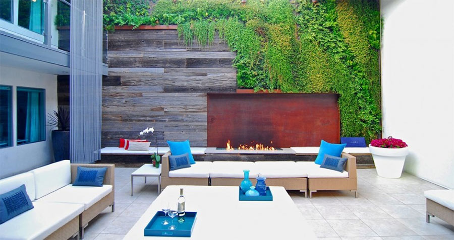 Outdoor lounge at Hotel Seven 4 One in Laguna Beach uses reclaimed wood paneling