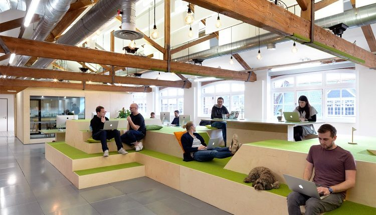 Wood stadium seating allows for greater office interaction and collaboration