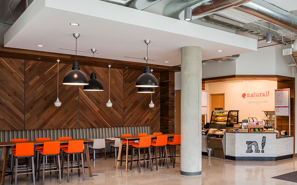Cafe at Toyota's new HQ in Texas is cladded with reclaimed walnut paneling