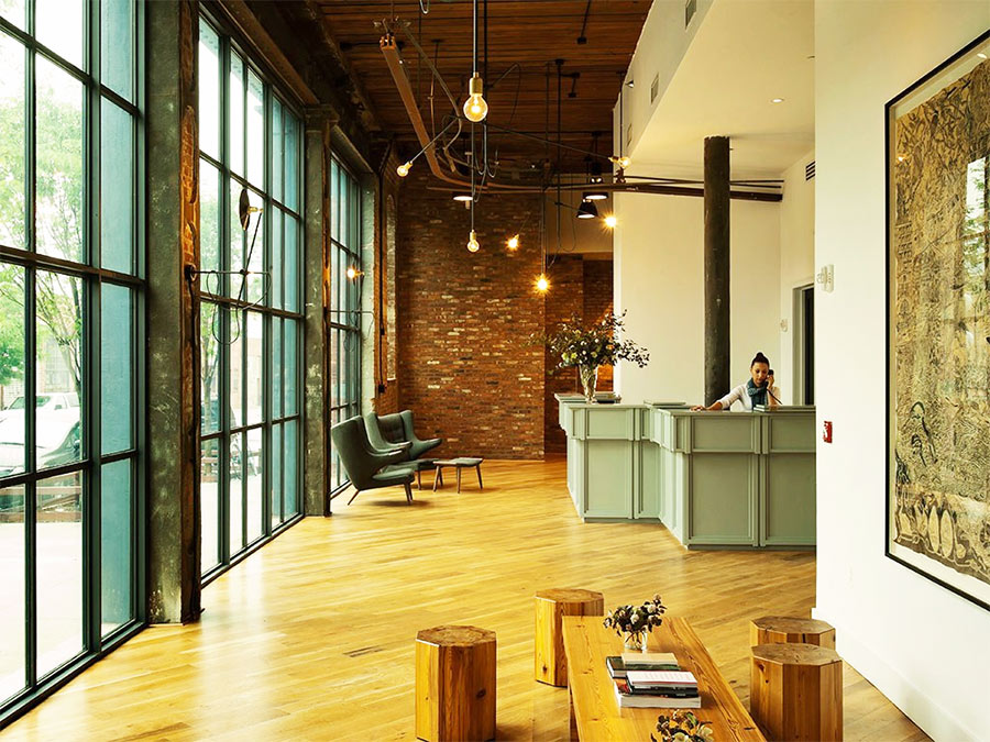 Reclaimed wood flooring is throughout the Whyth Hotel lobby in New York