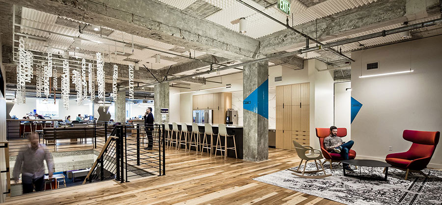 Durable reclaimed wood flooring at Ankrom Moisan HQ in Seattle