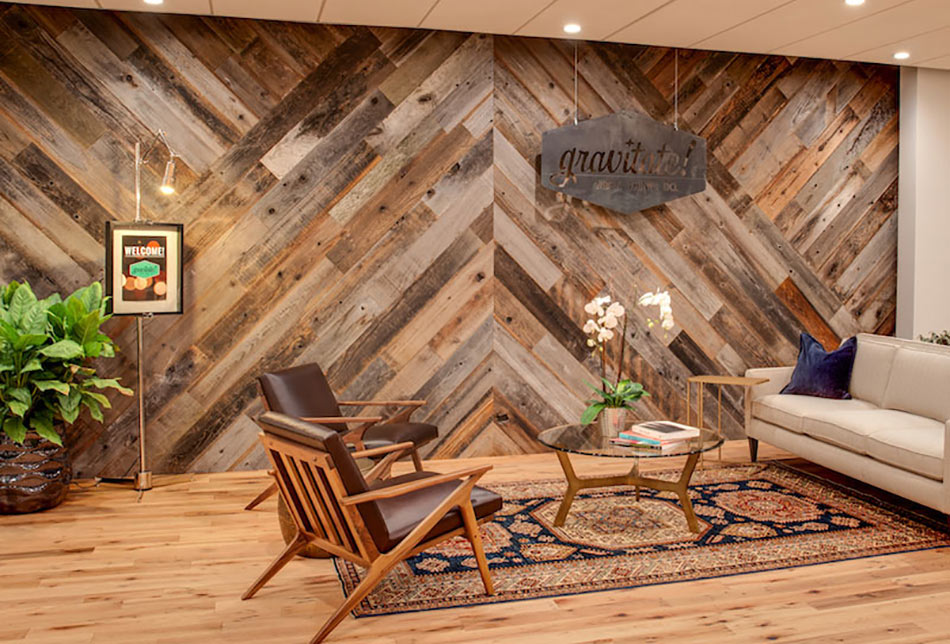 Gravitate uses reclaimed wood paneling in a chevron pattern to provide biophilic and aesthetic benefits