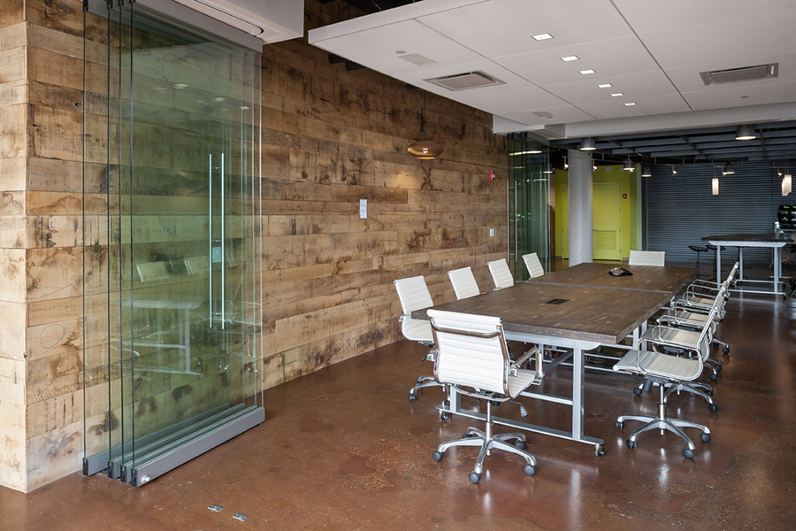 Reclaimed wood in conference room adds to the wabi sabi