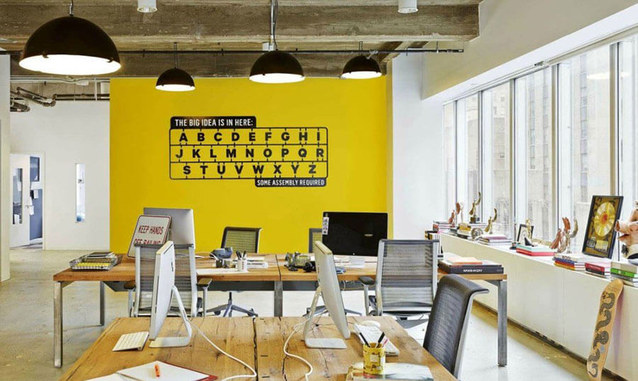 Reclaimed wood desks at BBDO office