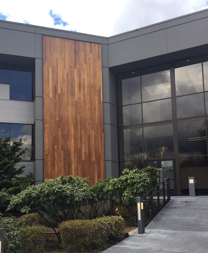 Reclaimed Surfaced Teak Siding on facade of the Onward building in Seattle