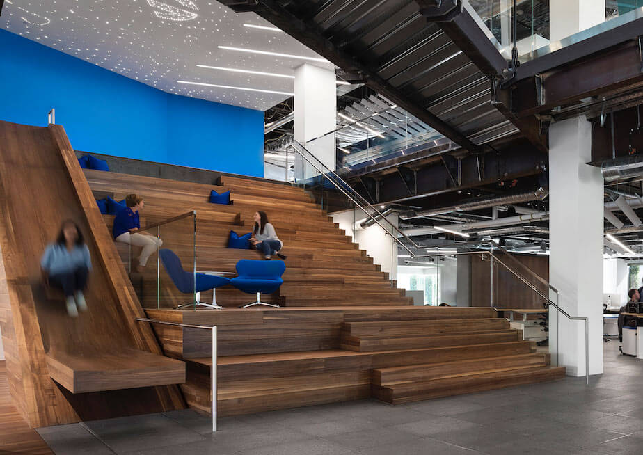 Walnut Stairs, Stadium Seating, And A Slide At Autogravity