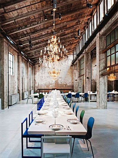 Industrial dining hall with wood ceiling and chandelier