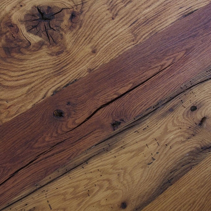 Closeup of reclaimed oak tabletop shows multitude of patterns