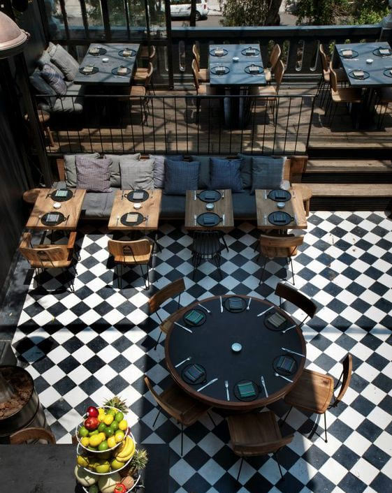 Restaurant combines retro vinyl flooring and wood tables