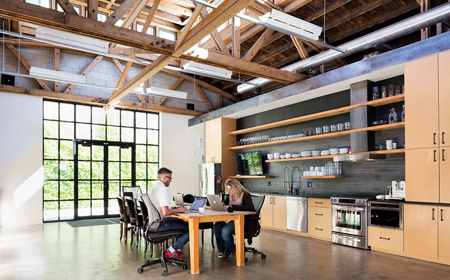 Open work space with wood accents at Saarofsky Studio