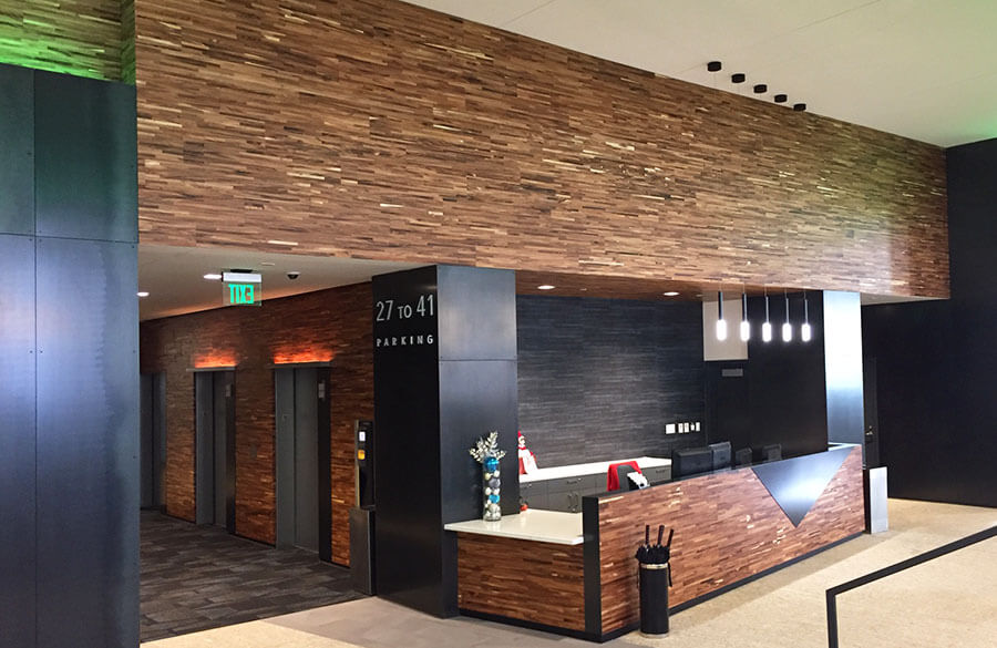 TerraMai's Reclaimed Acacia Metro Paneling greets occupants at 5th Ave apartments