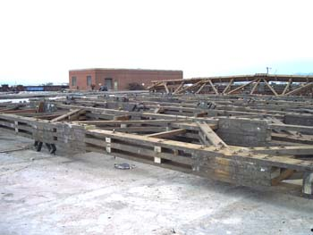 The beams formed massive trusses like this one, which held up over 5 acres of roof.