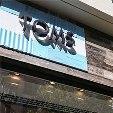 exterior reclaimed wood paneling on Toms retail store