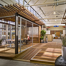 Clif Bar HQs filled with reclaimed wood flooring, paneling, & benches