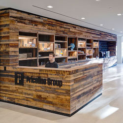 Reclaimed wood reception desk at Priceline